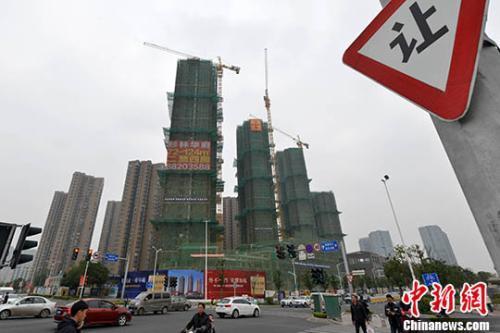 资料图:商品房在建中。 <a target='_blank' href='http://www.chinanews.com/'>中新社</a>记者 吕明 摄